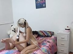 Hot lesbos playing with massager on bed