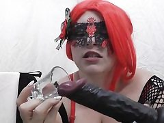 Kinky babe wearing crimson wig and a net cock-squeezing all over her body